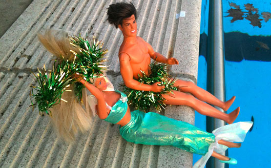 Barbie & Ken watch from the poolside at Tooting Bec Lido