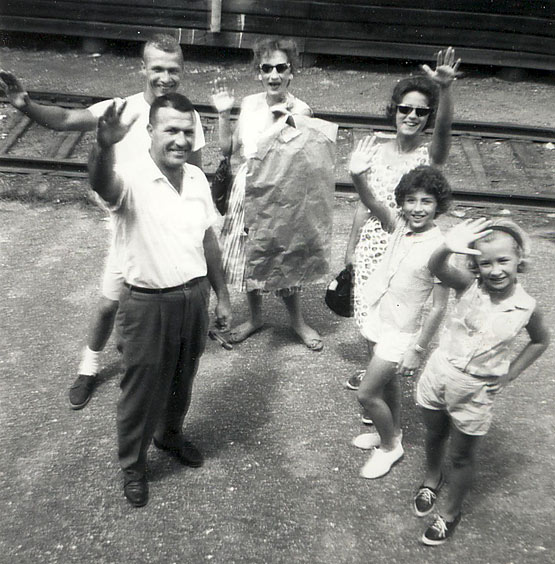 Family waving goodbye. Photo: G. J. Charlet III on Flickr